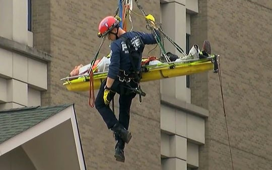 Images from the construction rescue near Cincinnati Children's Hospital Medical Center Friday.