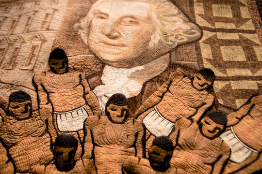 """""""Let Freedom Ring,"""" a quilt by by Carolyn Crump,  hangs in the exhibit entitled """"We Who Believe In Freedom"""" curated by Dr. Carolyn Mazloomi and the Women of Color Quilters Network on display at the National Underground Railroad Freedom Center on Friday, April 5, 2019, in Cincinnati."""