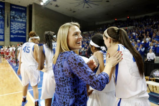 Then-assistant coach Camryn Whitaker congratulates the University of Kentucky women's basketball team after it defeated Oklahoma 79-58 to advance to the Sweet 16 in 2016.