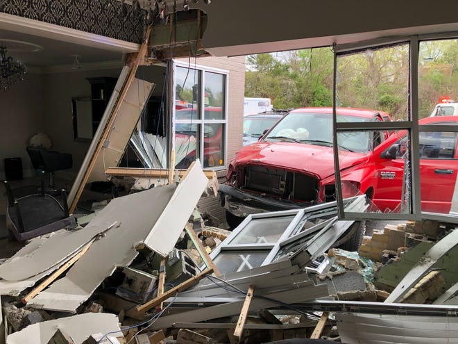 A red truck crashed into The Edge Salon on Madison Street on Friday, April 5, 2019.