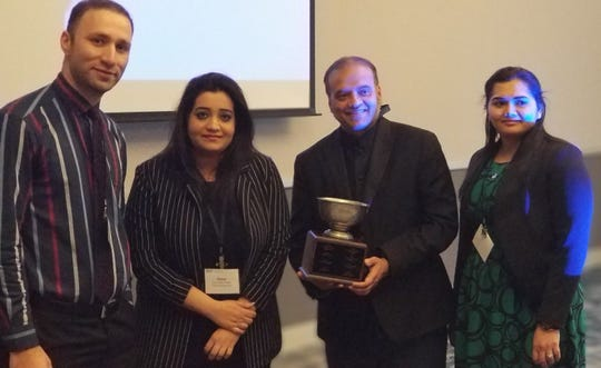 At the New Jersey Chapter of the ACP's Scientific Meeting in Princeton, N.J., from left, is Ali Nadhim, M.D., Sana Najib, M.D., Shuvendu Sen, M.D., and Kanwal Farooq, M.D., with the championship trophy.