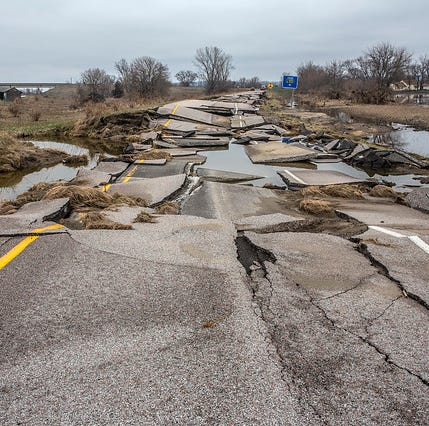 Road damage and repair in southwest Iowa after historic Missouri River flooding.