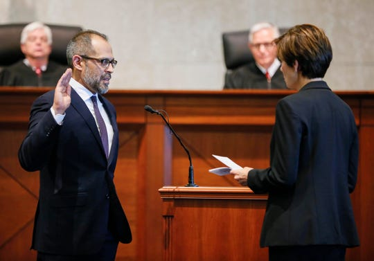 Governor Kim Reynolds swears in new Iowa Supreme Court Justice Christopher McDonald in the Iowa Supreme Court Friday, April 5, 2019.