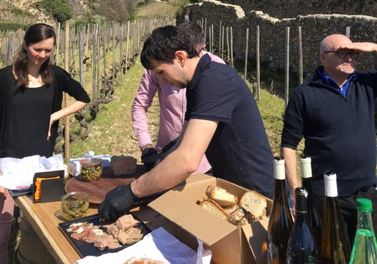 Chef Etienne Place, contest winner from 2009, caters memorable picnic in Hermitage vineyard.