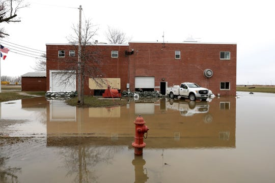 The Glenwood, Iowa, water plant stands in flood waters Wednesday, April 3, 2019. Glenwood's wells and water-treatment plant were inundated by flood waters and are now being repaired and tested. Several communities along the Missouri River continue to struggle to restore drinking water service weeks after massive flooding disrupted life in the towns and caused significant damage.