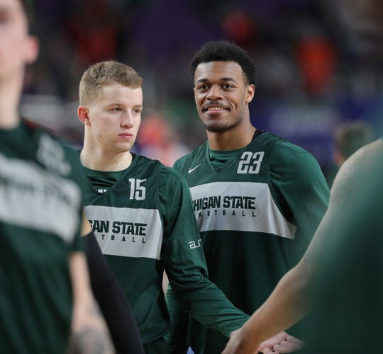 Michigan State's Thomas Kithier and Xavier Tillman go through drills during practice for their NCAA semifinal game against Texas Tech Friday, April 5, 2019 at U.S. Bank Stadium in Minneapolis, Minn.