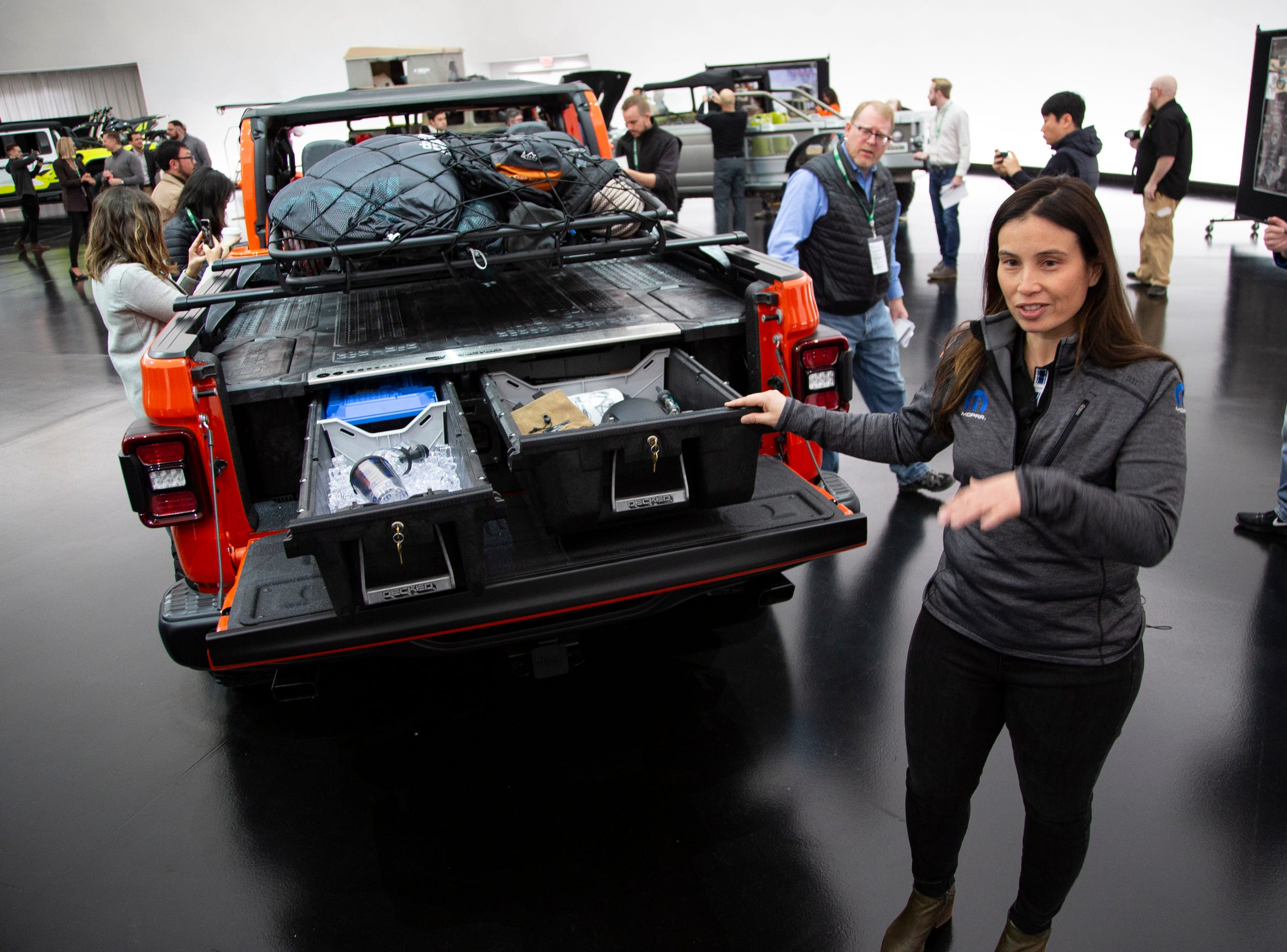 Jeep and Mopar brands debut six concept vehicles including the Jeep Gladiator Gravity Friday, April 5, 2019 at the Fiat Chrysler Tech Center and headquarters for the 53rd annual Moab Easter Jeep Safari. The Jeep Gladiator Gravity is a rock-climber-themed concept colored in Punk'N Metallic Orange. Steel tube doors allow for a more open air concept. The bed offers the Mopar/Decked truck bed storage system with dual sliding drawers for lockable cargo demonstrated by Kim Mathers, Head of Mopar Performance and Accessories Portfolio.