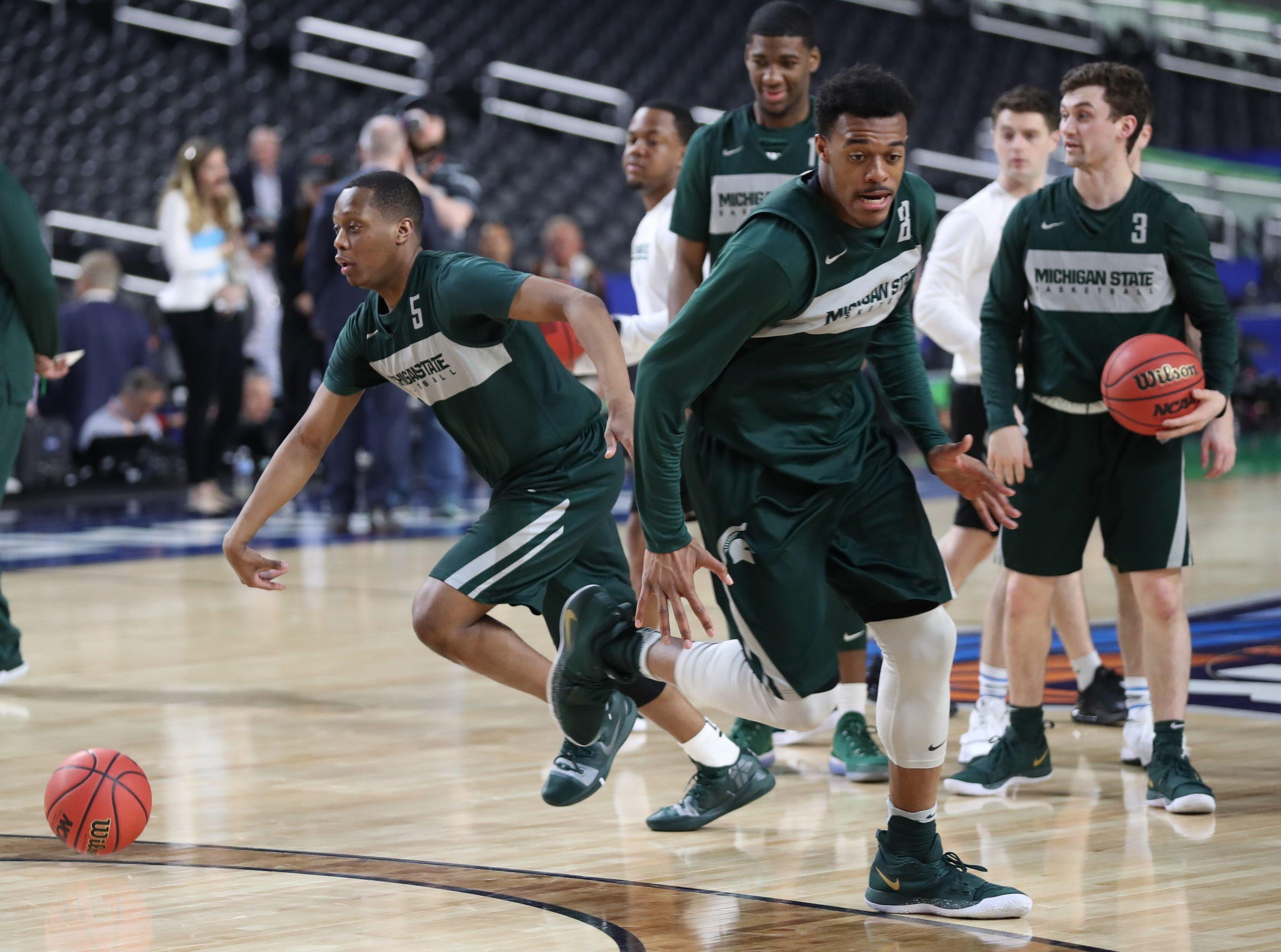 Michigan State's Cassius Winston and Xavier Tillman goes through drills during practice for their NCAA semifinal game against Texas Tech Friday, April 5, 2019 at U.S. Bank Stadium in Minneapolis, Minn.
