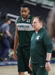 MSU head coach Tom Izzo and Nick Ward talk during practice on Friday, April 5, 2019 at  U.S. Bank Stadium in Minneapolis.