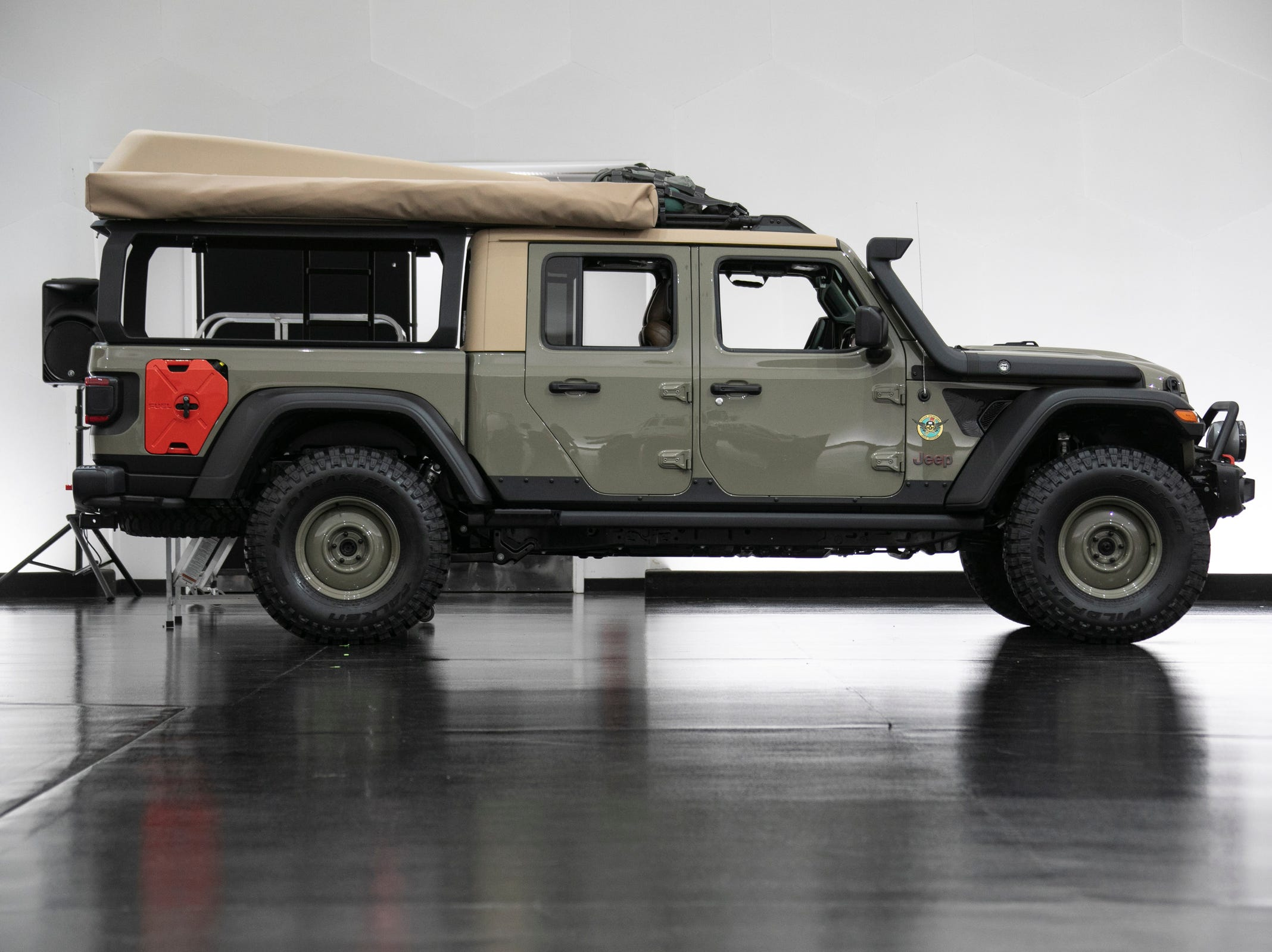 Jeep and Mopar brands debut six concept vehicles including the Jeep Wayout Friday, April 5, 2019 at the Fiat Chrysler Tech Center and headquarters for the 53rd annual Moab Easter Jeep Safari. The Jeep Wayout showcases a full roof-top tent and custom, large sprawling canopy. The Wayout's body armored exterior features a new Gator Green color that will be available on all production Gladiator models.