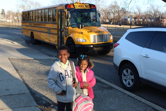 The GOAL Line bus drops Dkari and Brooklin George, 8 and 6 years old, at 6 p.m. at Cornerstone Lincoln-King Academy, near their home.