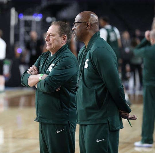 Michigan State head coach Tom Izzo and Mike Garland watch drills during practice for their NCAA semifinal game against Texas Tech Friday, April 5, 2019 at U.S. Bank Stadium in Minneapolis, Minn.