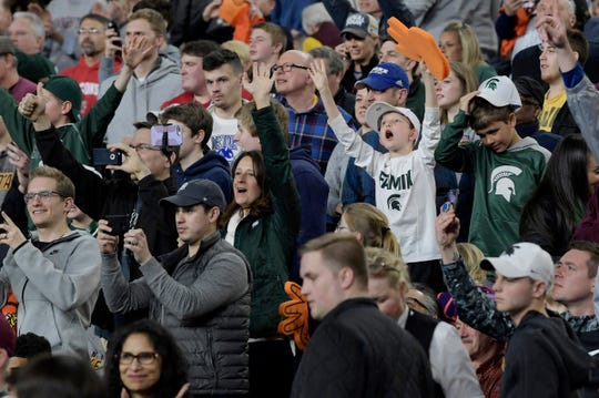 Michigan State fans cheer at the end of an open practice at U.S. Bank Stadium during the Final Four in Minneapolis on Friday, April 5, 2019.