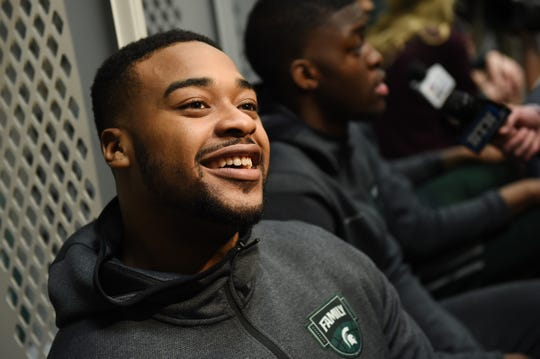 Michigan State's Nick Ward (44) smiles during an interview in the locker room at U.S. Bank Stadium during the Final Four in Minneapolis, Minnesota on Friday, April 5, 2019.