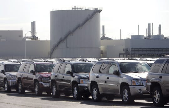 SUVs ready to be moved out are lined up at the GM Truck Group assembly plant in Moraine, Ohio, Oct. 17, 2005.