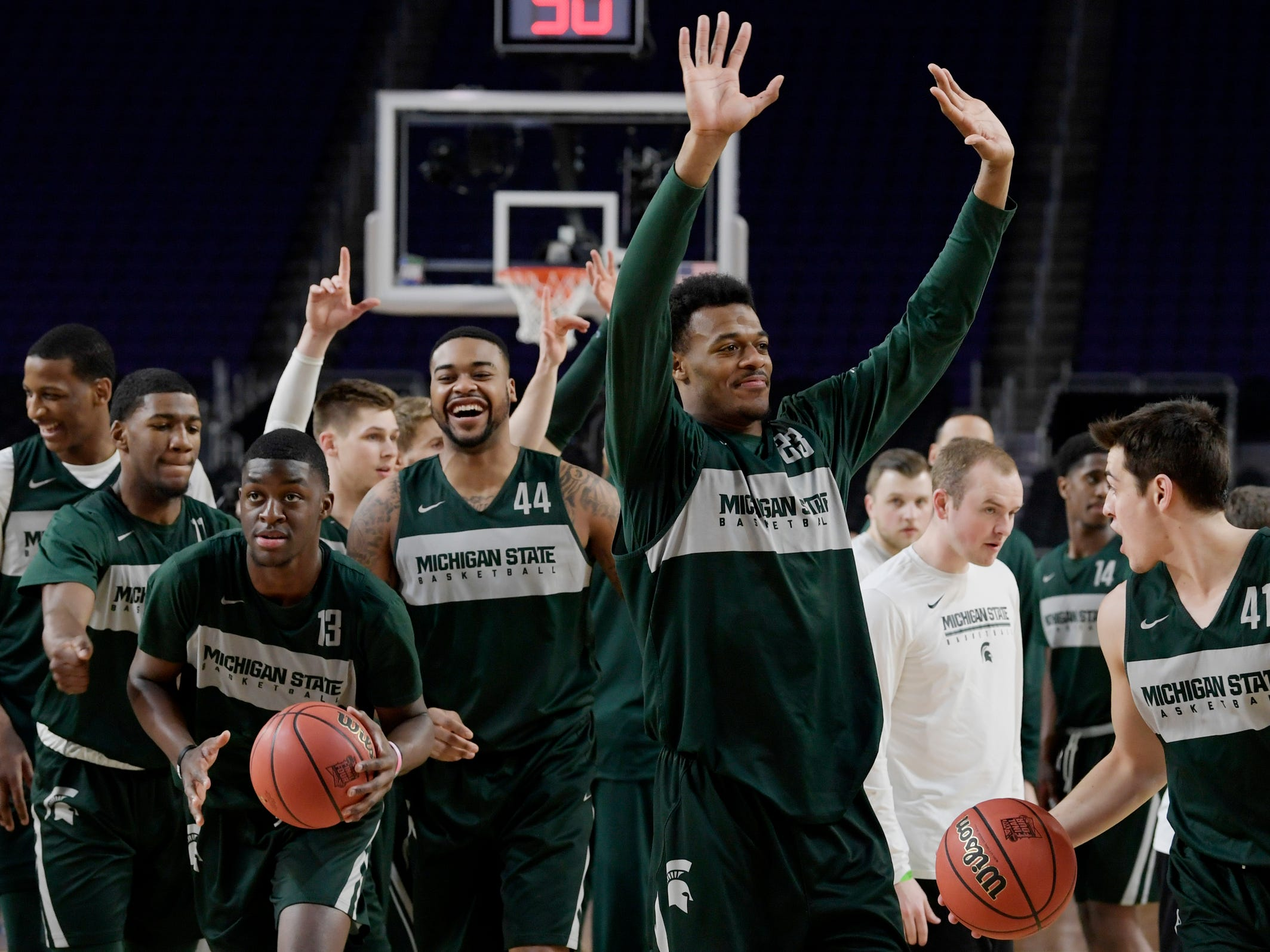 Michigan State forward Xavier Tillman (23) waves to the crowd as the team finishes an open practice at U.S. Bank Stadium during the Final Four in Minneapolis on Friday, April 5, 2019.