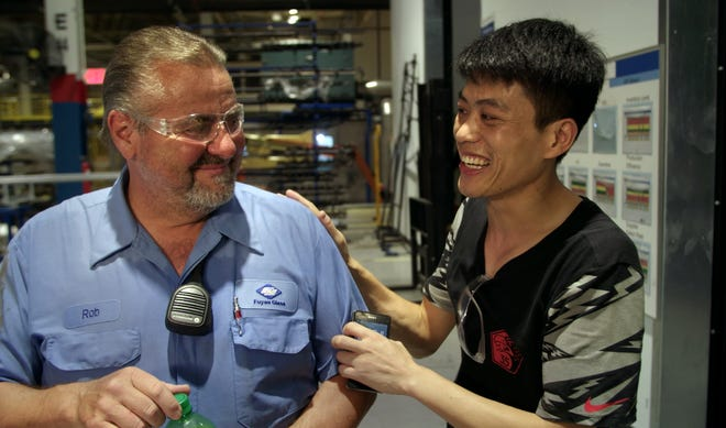 """The documentary film """"American Factory"""" tells the tale of Americans and Chinese trying to work side-by-side in an automotive glass factory that was once General Motors Moraine Assembly plant in Ohio."""
