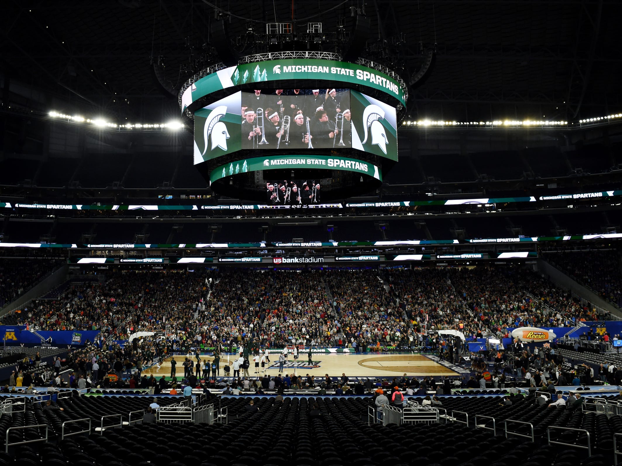 Fans watch as Michigan State holds an open practice at U.S. Bank Stadium during the Final Four in Minneapolis on Friday, April 5, 2019.