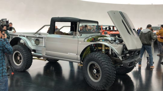 The Jeep Five-Quarters concept pickup is based on a Vietnam-era M715 Army pickup.