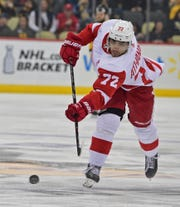 Detroit Red Wings forward Andreas Athanasiou shoots the puck in the first period against the Pittsburgh Penguins at PPG PAINTS Arena in Pittsburgh, Thursday, April 4, 2019.