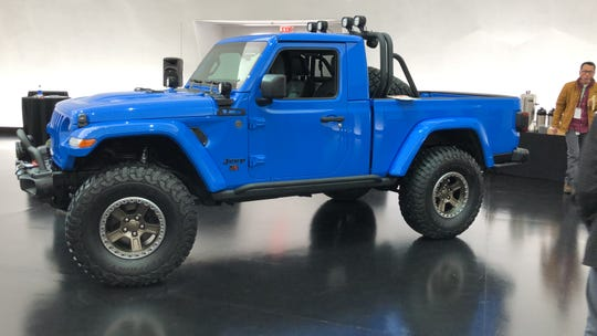 The Jeep J6 concept is a mashup of the front seat of a Wrangler and the beds of two Gladiator pickups.