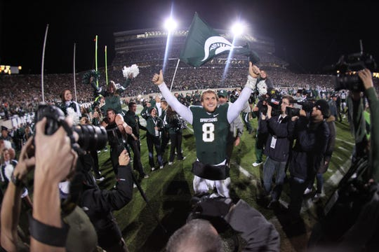 Michigan State's QB Kirk Cousins celebrates in front of the student section after his Hail Mary TD pass to Keith Nichol for the winning touchdown as time expired for a 37-31 win over Wisconsin in East Lansing on Oct. 22,  2011.