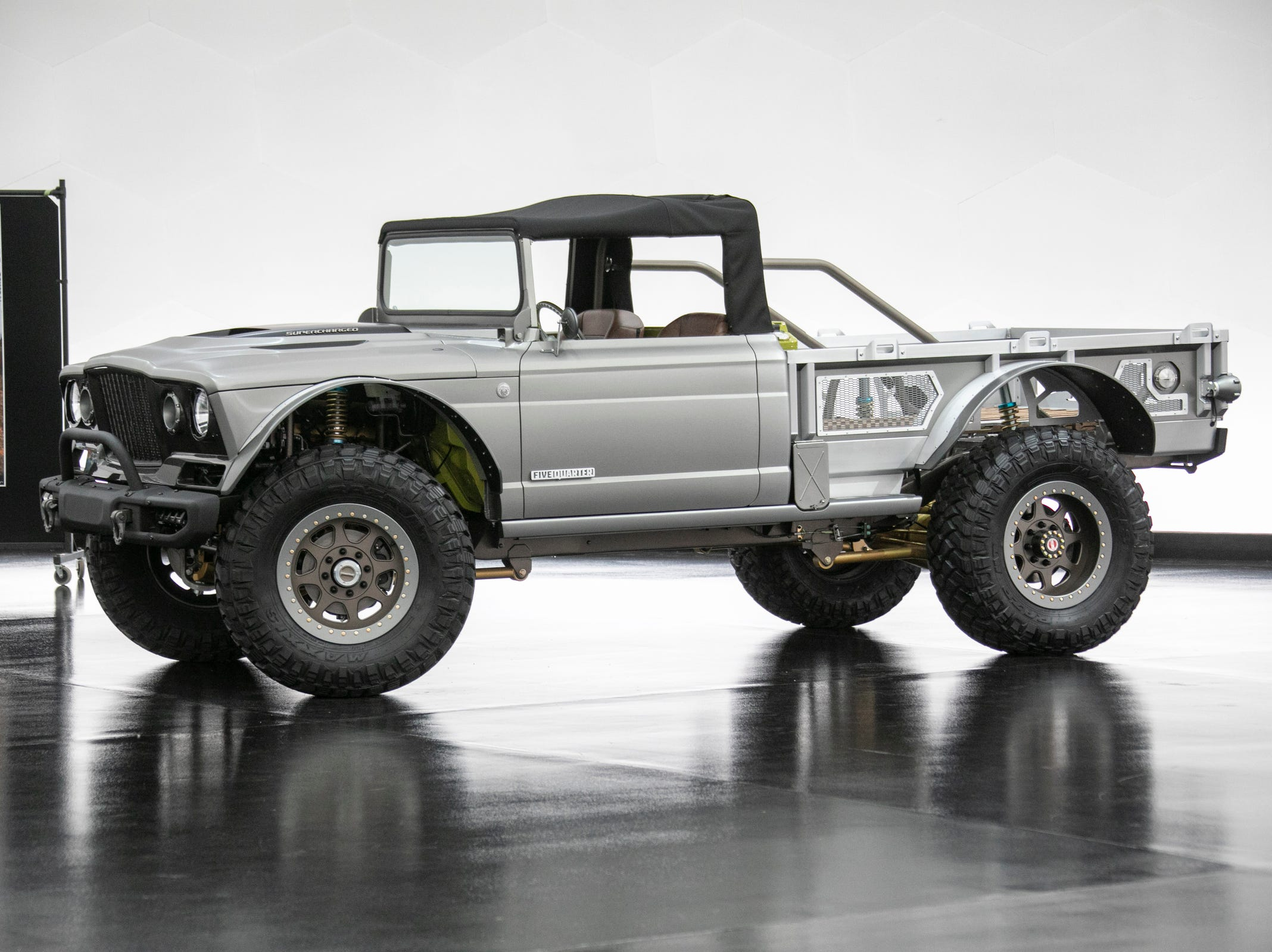 Jeep and Mopar brands debut six concept vehicles including the Jeep M-715 Five-Quarter Friday, April 5, 2019 at the Fiat Chrysler Tech Center and headquarters for the 53rd annual Moab Easter Jeep Safari. The Jeep M-715 Five-Quarter is a blend of of vintage and modern components. The term Five-Quarter is a historical reference to Jeep trucks of the past that were one-and-one-quarter tons or five quarters. Starting with a 1968 M-715, this Gladiator-based military vehicle was re-imagined with improvements to ist chassis, drivetrain and cargo configuration. The color name for this vehicle is Gin and Tonic.