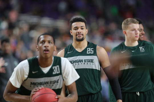 Michigan State's Marcus Bingham Jr. and Kenny Goins go through drills during practice for their NCAA semifinal game against Texas Tech Friday, April 5, 2019 at U.S. Bank Stadium in Minneapolis, Minn.