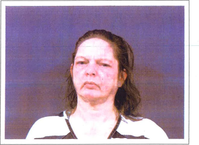 Angela Shock was arrested by Monroe Police after officers discovered she had been living with her dead boyfriend for a month.