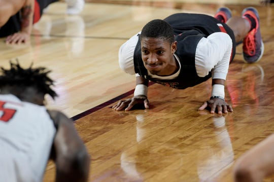 Texas Tech senior Tariq Owens grimaces while doing pushups during a practice open to the public before the Final Four at U.S. Bank Stadium in Minneapolis on Friday, April 5, 2019.