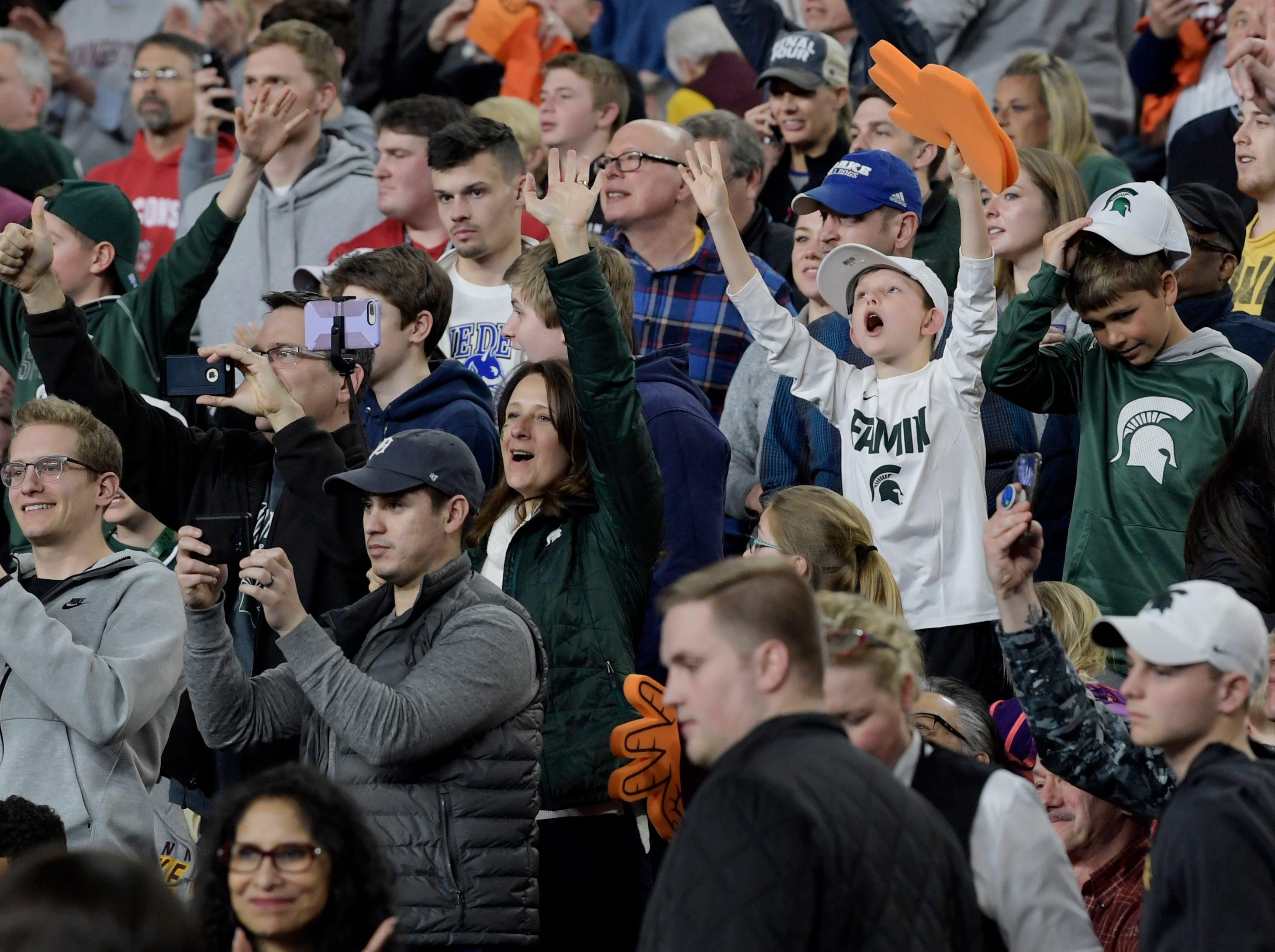 Michigan State fans cheer at the end of an open practice at U.S. Bank Stadium during the Final Four in Minneapolis, Minnesota on Friday, April 5, 2019.