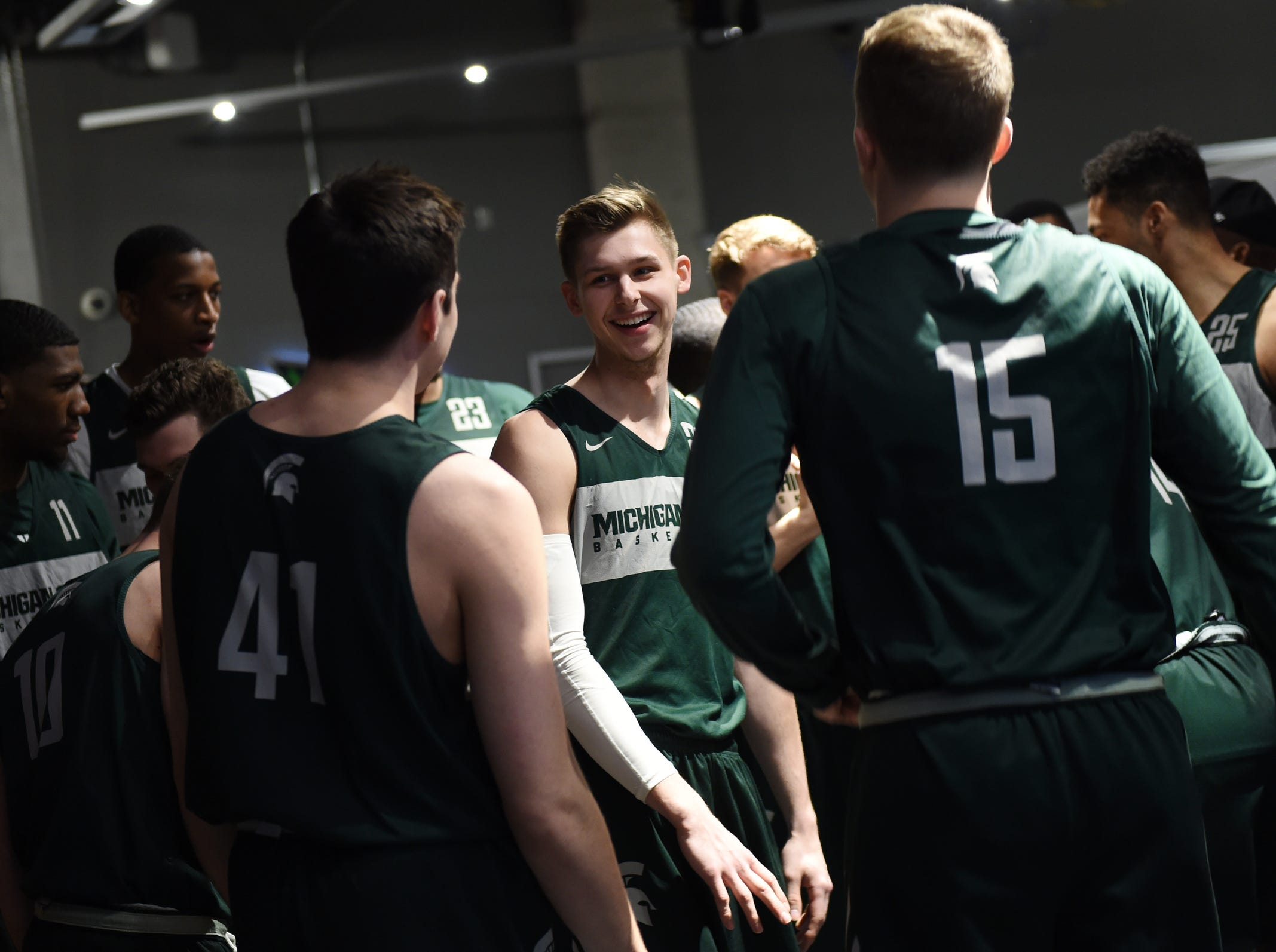 Michigan State guard Matt McQuaid (20) jokes around with teammate before they take the court for an open practice at U.S. Bank Stadium during the Final Four in Minneapolis, Minnesota on Friday, April 5, 2019.