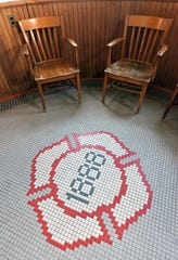 The Manistee Fire Department's station still displays an original floor when walking into the department. (Designed in 1888, the fire hall opened in 1889.) A circular entrance leads into the first floor, where fire engines are parked.