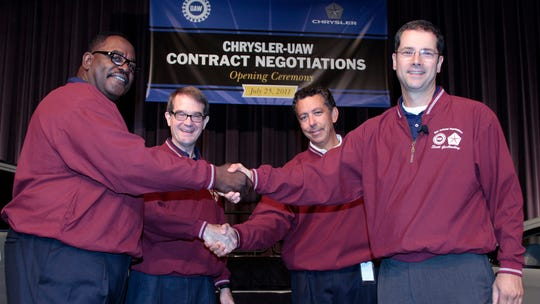 Former UAW Vice President General Holiefield, left, and President Bob King, shake hands with Fiat Chrysler Vice President Alphons Iacobelli and Chrysler Senior Vice President of Manufacturing Scott Garberding in July 2011 to mark the start of contract negotiations.