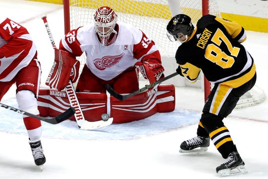 Detroit Red Wings goaltender Jimmy Howard stops a shot by Pittsburgh Penguins' Sidney Crosby.