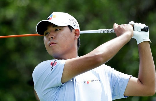 Si Woo Kim watches his drive on the ninth hole Thursday.