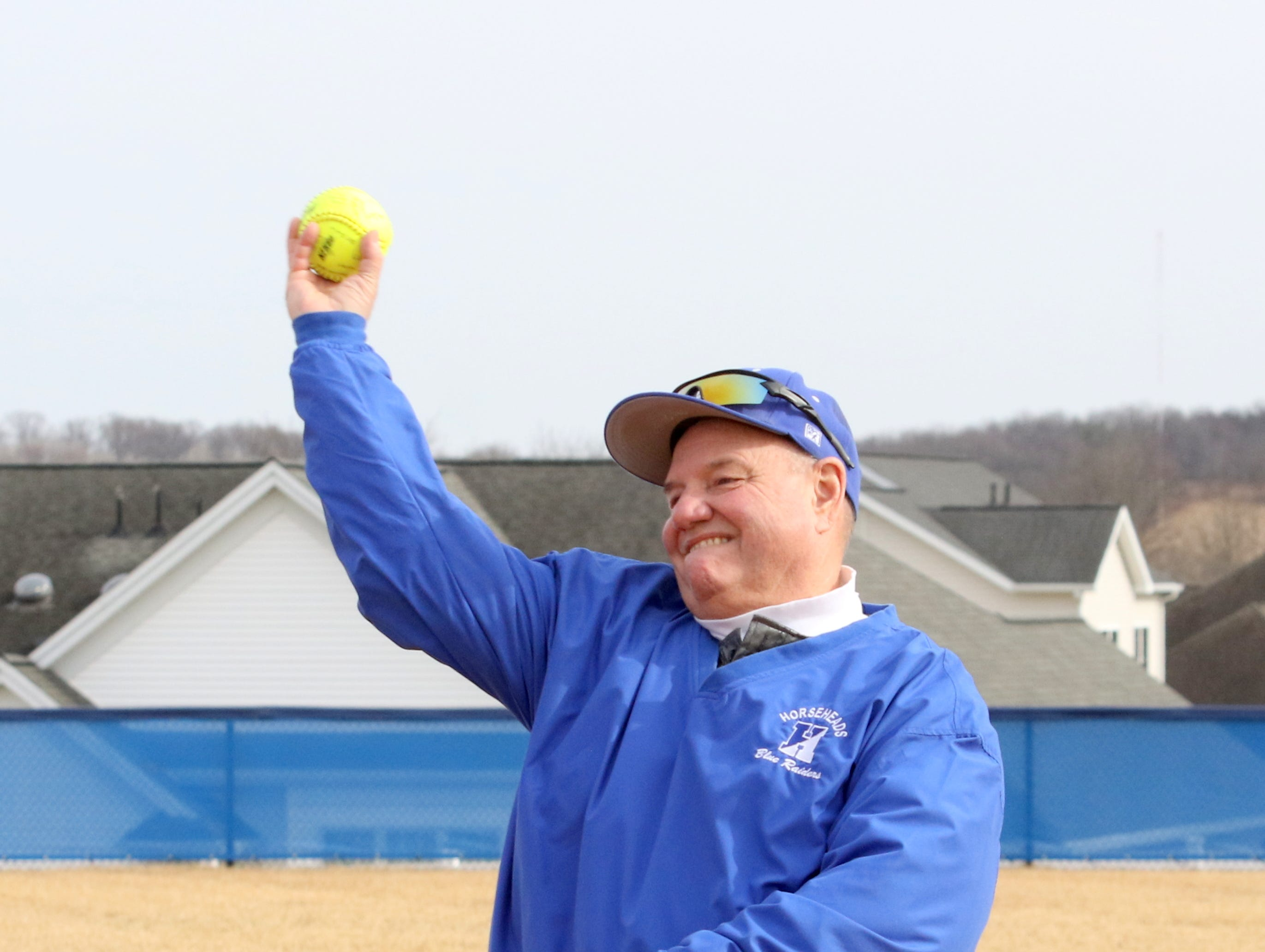 Retired Horseheads softball coach Warren Conklin throws out the ceremonial first pitch before Owego at Horseheads softball April 4, 2019 at Horseheads Middle School.