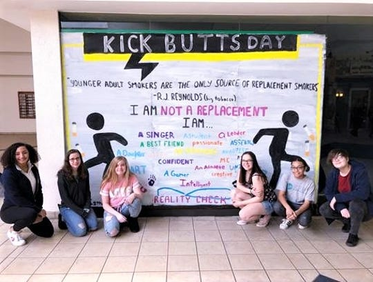 From left, Merica Griffin, Krissi Elliot, Morgan Elliot, Savannah Ayers, Trinity Hammock and Olivia Mitchell pose with their Kick Butts Day poster at the Arnot Mall.