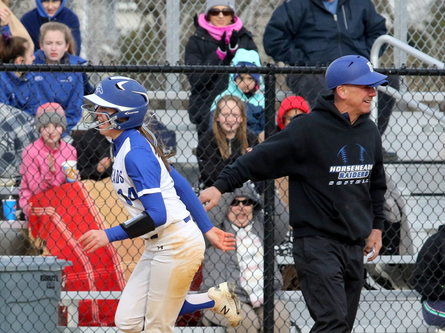 Horseheads head coach Al Falkowski congratulates Maiah Skakal after her homer against Owego on April 4, 2019 at Horseheads Middle School.