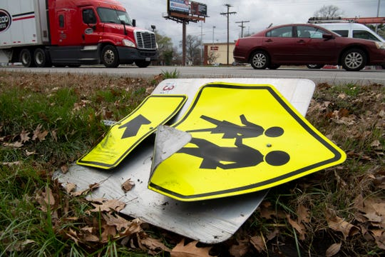 A pedestrian crossing road sign was plowed over by a vehicle at the intersection of Hwy 41 and Washington Avenue just minutes before Bosse High School students were let out of school Friday afternoon. Crossing guards have been hired to help with safety concerns.