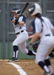 Reitz junior Victoria Garland (8) scores teammate Brooke Wilhite from third base with a ground out against Mater Dei.