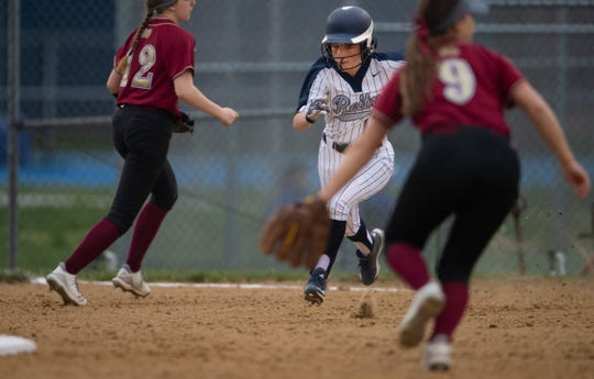 Reitz's Brooke Wilhite (1) steals second base against Mater Dei. The Panthers are 13-1 going into a game against Castle on Thursday.