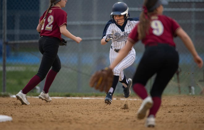 Reitz senior Brooke Wilhite (1) steals second base against Mater Dei at the Barker Avenue Athletic Complex. The Panthers are ranked No. 8 in Class 4A.