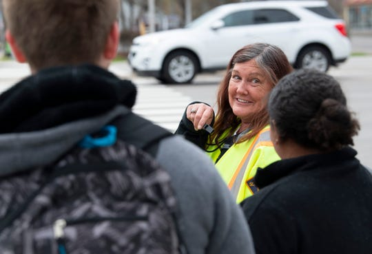 Crossing guard Sandy Mahady visits with Bosse High School students who are waiting to cross Hwy 41 at the Washington Avenue intersection Friday afternoon.
