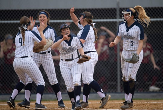 The Reitz infielders celebrate the second out of the first inning against Mater Dei. The Panthers, ranked No. 8 in Class 4A, are one of the best teams in Southern Indiana.