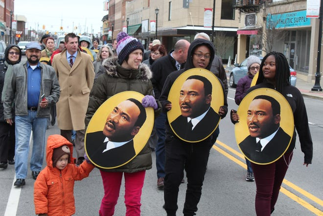 Fremont residents held a unity march on Front Street Thursday night in honor of the Fremont NAACP branch's first Dr. Martin Luther King Jr. week. The week included a visit to Fremont from state NAACP President Tom Roberts and a city-wide oratorical contest for students.