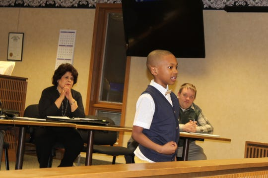 Jeriah Martin, 7, of Fremont delivers a speech about Martin Luther King Jr. before the Fremont City Council meeting Thursday evening. Martin participated in the city-wide MLK Week oratorical contest.