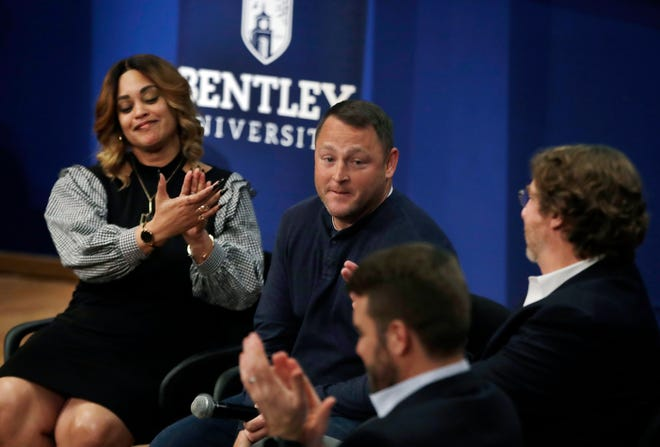 "In this March 5, 2019 photo, panel members including Natalie Baucum, left, applaud Mike Duggan, middle, during an event at Bentley University, in Waltham, Mass., where professors and alumni shared some of their worst setbacks to illustrate that even successful people sometimes fail. A growing number of U.S. colleges are trying to ""normalize"" failure for a generation of students who increasingly struggle with stress, anxiety and the ability to bounce back from adversity. (AP Photo/Elise Amendola)"