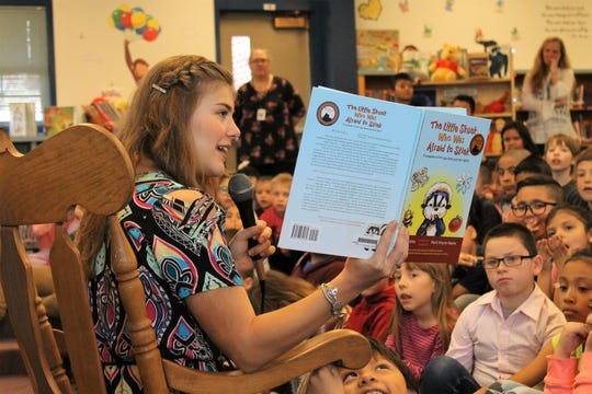Fort Collins author Brielle Kelley reads her book out loud to students at Irish Elementary School March 28. Kelley kicked off a national book tour in her hometown. She hopes to encourage kids to know their value and build supportive friendships.