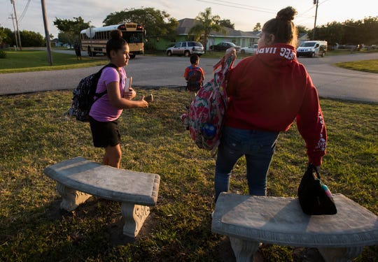 From left, Carolina Vega, 10, Zak Woods, 8, and Ava Pellechio, 10, all students at Gulf Elementary in Cape Coral, waited for their school bus on a privately installed bench.